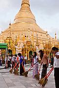 Sweeping the plaza surrounding the Shwedagon Pagoda, Yangon, Myanmar.
