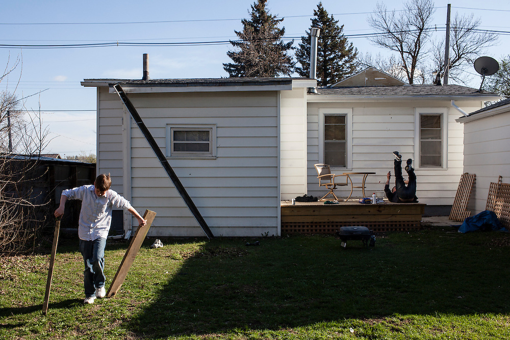 Joe McFarland, left, and his father Steve McFarland in their back yard on Friday, March 23, 2012 in Webster City, IA.