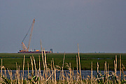 Crane on a barge near the Rigolets, Orleans Parish, Louisiana