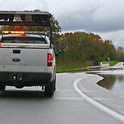 10/30/12 - Smyrna, DE - Hurricane Sandy - A D.O.T Truck blocks a flood part of woodland beach road Tuesday, Oct. 30, 2012, in Smyrna DE. ..SAQUAN STIMPSON/Special to The News Journal