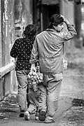 A family walking the streets of Zizkov.