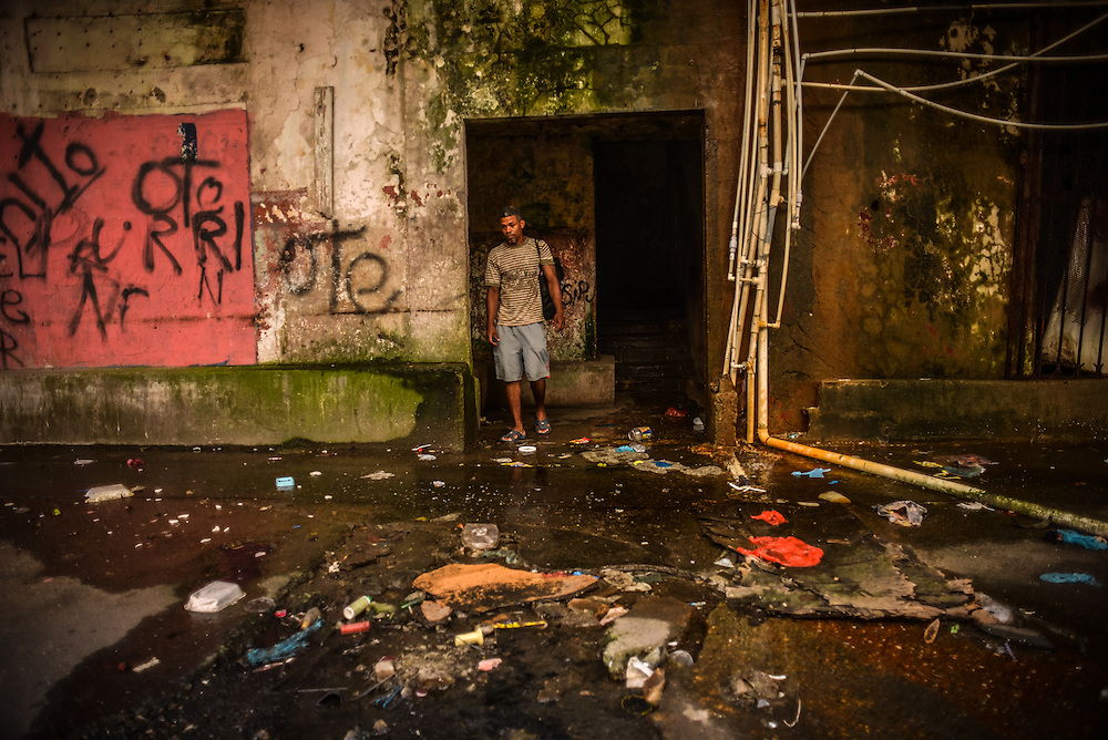 A squatter leaves a condemned building on  5th and Front Street, where he lives with dozens of other squatter families.  The squatters have gerry-rigged plumbing that drains sewage onto the street. Despite being the second largest city in Panama, Colón is one of the poorest in the region, and its residents suffer from a critical shortage of potable water, sewer connections and housing--many people live in condemned or should be condemned buildings. Panama is now one of the fastest growing countries in Latin America and there is a growing resentment and impatience that Colón has not reaped as much of the benefit as Panama City.