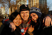 Windsor, Ontario. March, 2013. Three people pose after the Idle No More 'World Water Day' held at Dieppe Park. About thirty people including two Members of Parliament attend the cermony.