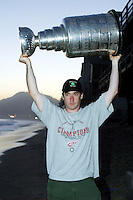 24 August 2002: Actor, Producer & Writer John Paul Cusack, 36 lifts the NHL Stanley Cup over his head on the beach during sunset at the Pacific Ocean after the Detroit Red Wings won the season trophy. .