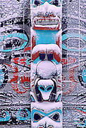 Alaska. Haines. Fort Seward. Tlingit Park. Detail of snow covered totem.
