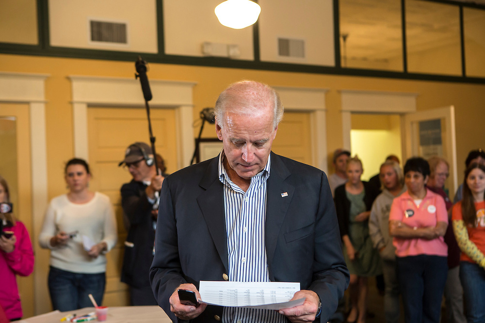 Vice President Joe Biden looks over a phone banking list during an unscheduled stop at a campaign field office while on a two-day campaign swing through Iowa on Monday, September 17, 2012 in Ottumwa, IA.