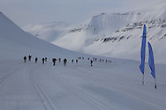 Skiers warm up for northernmost ski marathon in the world outside Longyearbyen on Spitsbergen island in April; Svalbard, Norway.