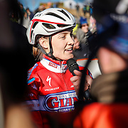 SHOT 1/12/14 3:16:43 PM - Elle Anderson (#4) of San Francisco, Ca. talks with the media after finishing second in the Women's Elite race at the 2014 USA Cycling Cyclo-Cross National Championships at Valmont Bike Park in Boulder, Co. Anderson finished second in the race with a time of 43:25. (Photo by Marc Piscotty / © 2014)