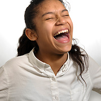 A Citizen Schools student laughs through her headshot session for Bridging Magazine.  Her article on a topic of her choosing will appear next to her headshot in the magazine.