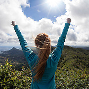 A woman stands at the Summit of Black River Peak, the highest peak in Mauritius, after a hike in Black River Gorges National Park. It is possible to hike many of the peaks seen in Mauritius using a guide or instructions on the website fitsy.com.