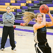 03/21/2014- Stevens Point, Wisc. - Tufts head coach Carla Berube watches as Hayley Kanner, A15, takes a shot during the morning shootaround for their NCAA Division III Women's Final Four game against FDU-Florham on Mar. 21, 2014. (Kelvin Ma/Tufts University)