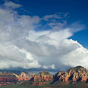 A fall thunderstorm passes over Brins Mesa and other peaks west of Sedona, Arizona. This scene was captured from the summit of Doe Mountain.