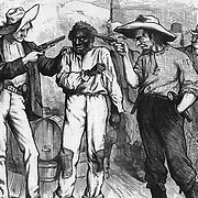 """""""Of course he wants to vote for the Democratic ticket""""  """"You're as free as air. ain't you?, say you are, or I'll blow yer black head off!"""" Blacks seeking protection of the law from KKK efforts to keep African-Americans from voting in free elections. Harper's Weekly political cartoon, October 21, 1876   Politics, Government, Elections"""