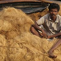 (MR) Sri Lanka, Farmer sits atop truck along southwest coast road