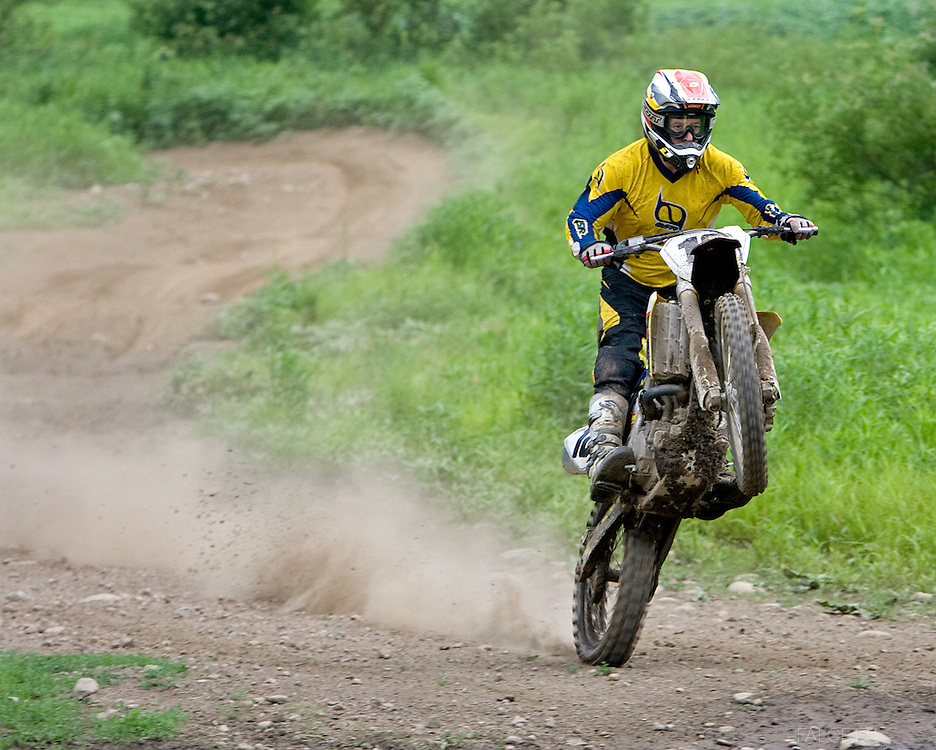 THOMASTON, CT-  6 June 2010-- New England professional motocross legend Jim Meenan, who won 29 New England Motocross Championships, rides a wheelie on one of the riding tracks during a day of trail riding at the U.S. Army Corps of Engineers Thomaston Dam in Thomaston, CT. The dam offers over 800 acres of public land use including trail bike riding. The riding season is open from May 1 through October 14.  (Photo by Robert Falcetti)