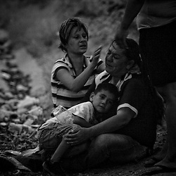 Family reacts near the scene of a the shooting of a 15 year-old boy who was killed by a U.S. Border Patrol agent in Ciudad Juarez, Chihuahua on June 7, 2010 after he had tried to cross into the United States.