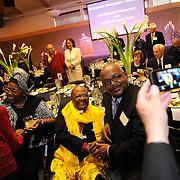 Madame Leah and Archbishop Tutu greet guests at the honoree dinner.