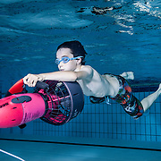 Boy with an underwater scooter