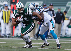 Nov 29, 2009; East Rutherford, NJ, USA; New York Jets tight end Dustin Keller (81) runs after making a catch while Carolina Panthers cornerback Sherrod Martin (23) defends during the first half at Giants Stadium.