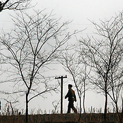 A North Korean soldier guards in the Yalu river bank in Sinuiju,North Korea, on Wednesday, Feb.  9, 2007. As The Six Party talks resume in Beijing the US envoy is ompimistic on North Korean nuclear talks.