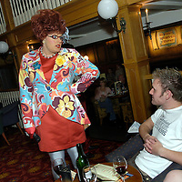 Visitors enjoy the entertainment and a drink in the Alton Towers Hotel Bar, Alton Towers, UK..Photo©Steve Forrest/Workers' Photos.