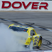 Joey Logano (22) of team Hertz celebrates by doing a burnouts after winning the NASCAR Nationwide Series 5-HOUR ENERGY 200 auto race at Dover International Speedway in Dover, DE., Saturday,  June 01, 2013.