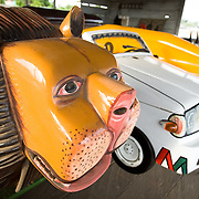 Coffins shaped as lions, cars and cocoa pods are seen on display at the Hello Design Coffins shop in Teshie, on the outskirts of Ghana's capital Accra, on Tuesday December 9, 2008.  Is it a tradition in Ghana to bury people in coffins shaped to represent their life's work. For instance, a chief would be buried in a lion-shaped coffin, a driver in a car-shaped one, and a cocoa farmer in one shaped as a cocoa pod..