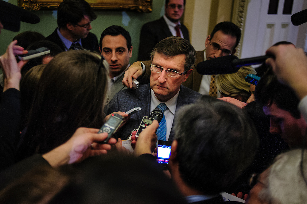 Senator Kent Conrad (D-ND) is questioned by reporters following a party caucus meeting at the U.S. Capitol. Fiscal cliff negotiations continue at the U.S. Capitol in Washington, District of Columbia, U.S., on Sunday, Dec. 30, 2012. A combination of spending cuts and tax increases are set to kick in within hours unless congressional Republicans and Democrats cut a last-minute deal. Photographer: Pete Marovich/Bloomberg