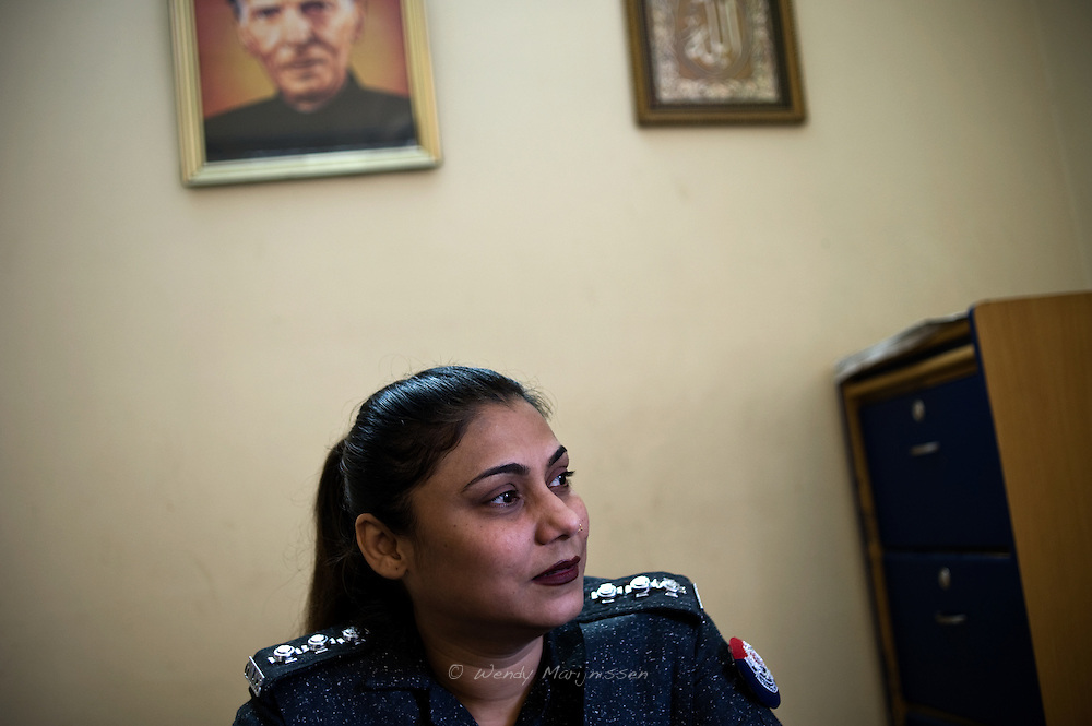 Lady police inspector Anila Unar of the West Karachi Police Station.<br /> 'If they would give us the authority to lodge an F.I.R. (First information rapport) it would already make a big difference.<br /> Women come in our police station to start an investigation, but I can't do anything because I'm not authorized to do so.' Karachi, Pakistan, 2011