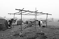 02 April 2016, Idomeni Greece - A man pray at sunrise outside the tent at refugees camp of Idomeni.