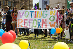 Old Palace Yard, Westminster, July 25th 2015. Protesters gather outside the Houses of Parliament to demand electoral reform, including proportional representation rather than the first-past-the-post method that saw the Tories gain a majority.