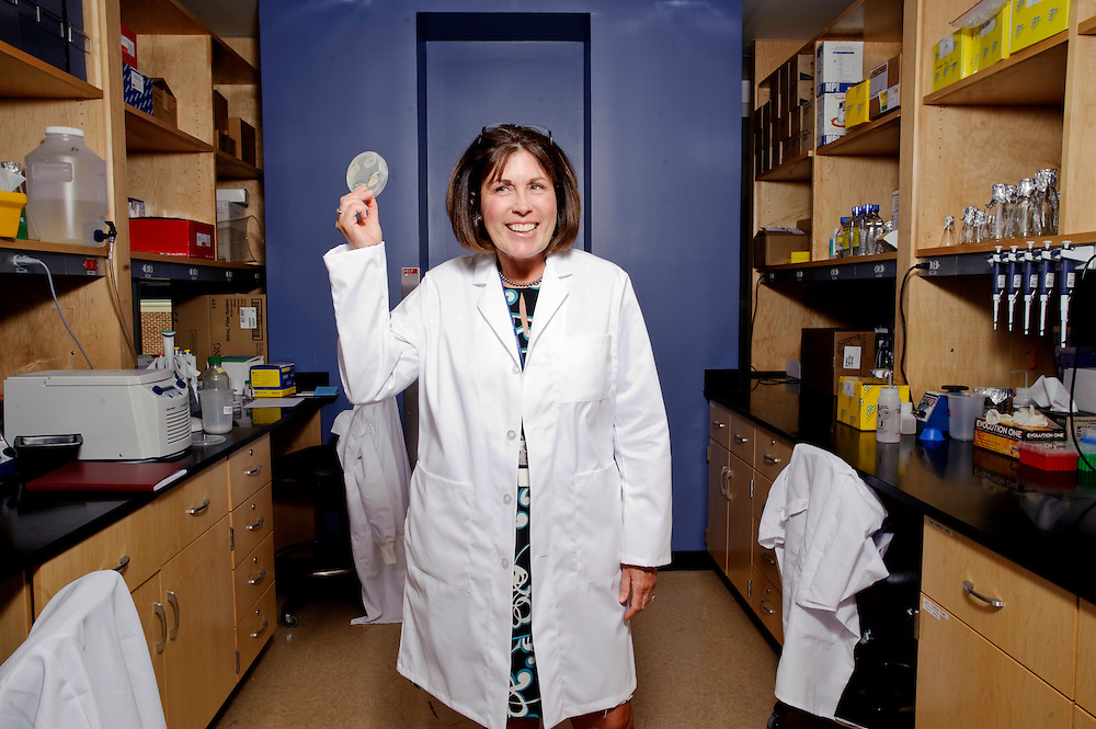 (staff photo by Matt Roth)..Dr. Claire Fraser-Liggett holds an agar plate of micro organisms that live in the human gastro intestinal tract...A giant in the genomic medicine world, Claire Fraser-Liggett, of Clarksville, director of the Institute for Genome Sciences at the University of Maryland School of Medicine was recently inducted in the Maryland Women's Hall of Fame. She primarily works with microorganisms that live in the human gastro intestinal tract, and studies how they effect such things as obesity. She is photographed in the lab at the Biomedical Park in Baltimore where most of the work she heads is done Tuesday, April 6, 2010.