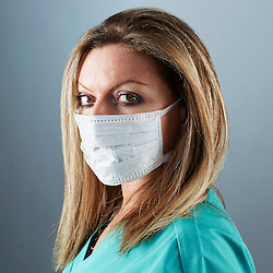 A portrait series representing the intense emotions that Doctors face.  A white female Doctor wearing a white surgical mask, and green medical scrub suit shown.