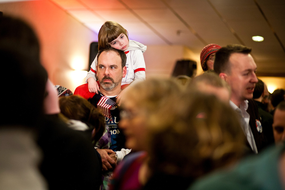 Jeff Noble and his daughter Lilly, 5, of Bedford, New Hampshire, wait for the arrival of Republican presidential candidate Ron Paul at his primary night rally at the Executive Court banquet facility on Tuesday, January 10, 2012 in Manchester, NH. Brendan Hoffman for the New York Times