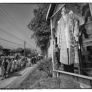 Villagers gather for the funeral of San Chumpu in Ta Pra Mok, Thailand, Saturday Dec. 28, 2013.