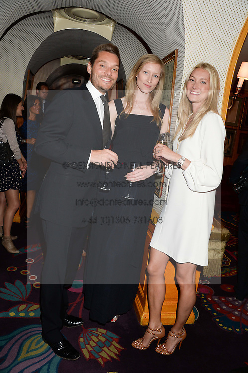 Left to right, SEB BISHOP, JADE PARFITT and  HEIDI BISHOP at the launch of Bluehouse, Samsung's Exclusive New members Club held at Annabel's, 44 Berkeley Square, London on 1st July 2013.