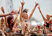 RFans soak up the atmosphere as Coheed and Cambria perform live on the Main Stage during Day One of Reading Festival 2012 at Richfield Avenue on August 24, 2012 in Reading, England.  (Photo by Simone Joyner)