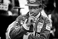 Niki Lauda came out of retirement for the 1982 Formula One season, racing for Marlboro McLaren, and believing he still had the ability to win. Here, he presents the classic Lauda pre-race stare. He was proven correct as he went on to win Long Beach that year, and his third World Formula One Driver&rsquo;s Championship in 1984.<br /> <br /> To say that Lauda had a pivotal place in the advancement of Formula One would be a vast understatement. <br /> <br /> He revitalized Ferrari in the mid-70's with dedicated testing and refinement, created an aura of invincibility when he returned to race and score points six weeks after near-fatal burns in 1976 in the championship battle with James Hunt, and win the World Championship in 1977 while becoming a force pushing for driver's safety. <br /> <br /> He would then leave to join Brabham and win a Grand Prix with infamous &quot;Fan-Car&quot;. When Brabham  faltered, he would retire, but return to win his third championship years later with McLaren.<br /> <br /> Political and outspoken, he would commentate on Austrian TV F1 broadcasts, try to lead the Jaguar F1 team, and finally join Mercedes in 2013 as the co-chairman of the Mercedes F1 team. <br /> <br /> As &quot;old school&quot; as it gets, Niki Lauda will remain a Formula One change agent far into the foreseeable future.