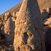 """A six-foot tall head of Zeus commemorates the lofty aspirations of pre-Roman King Antiochus (64-38 BC) at Mount Nimrod (Nemrut Dagi in Turkish), near Malatya, Turkey. Earthquakes toppled the stone heads from seated bodies long ago, but Mount Nemrut National Park may restore the site. Published in Wilderness Travel 2003 Catalog of Adventures, and in Sierra Magazine, Sierra Club Outings January/February 2001. Published in """"Light Travel: Photography on the Go"""" book by Tom Dempsey 2009, 2010."""