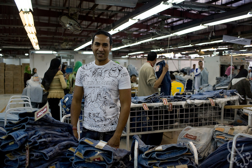 Siddharth Sinha, CEO of Vogue International Agencies FZE, inspects one of his blue jean production lines October 27, 2008 at the Velocity jeans factory in Ismailia (130 kilometers north of Cairo, Egypt.)  Siddharth, along with his father Air Marshal Man Mohan Sinha, have been operating their jeans factories in Egypt since 2001, employing 2700 Egyptian workers while supplying jeans to major companies that include Levis, Target, and Zara.
