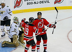 Oct 22, 2008; Newark, NJ, USA; New Jersey Devils center Travis Zajac (19) and New Jersey Devils right wing Jamie Langenbrunner (15) celebrate Langenbrunner's goal during the first period at the Prudential Center.