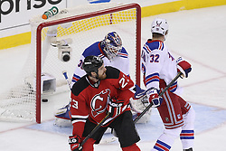 May 21, 2012; Newark, NJ, USA; New Jersey Devils defenseman Bryce Salvador (24) scores a goal on New York Rangers goalie Henrik Lundqvist (30) during the first period in game four of the 2012 Eastern Conference Finals at the Prudential Center.