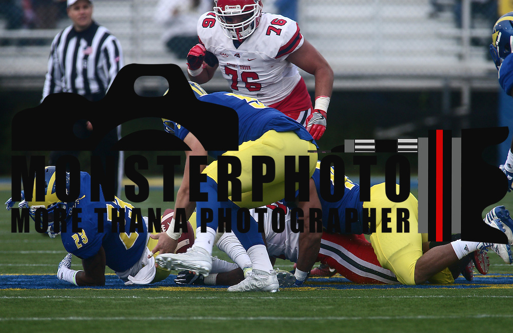 Delaware linebacker CHARLES BELL (5) recovers Stony Brook Running back JORDAN GOWINS (23) fumbles at the 49 yard line during a week eight game between the Delaware Blue Hens and the Stony Brook Seawolves, Saturday, Oct. 22, 2016 at Tubby Raymond Field at Delaware Stadium in Newark, DE.