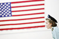 Sarena Kaschmitter, 11, performs as one of the Andrew Sisters during their USO inspired act Wednesday for the Winton Elementary Pearl Harbor Day assembly.