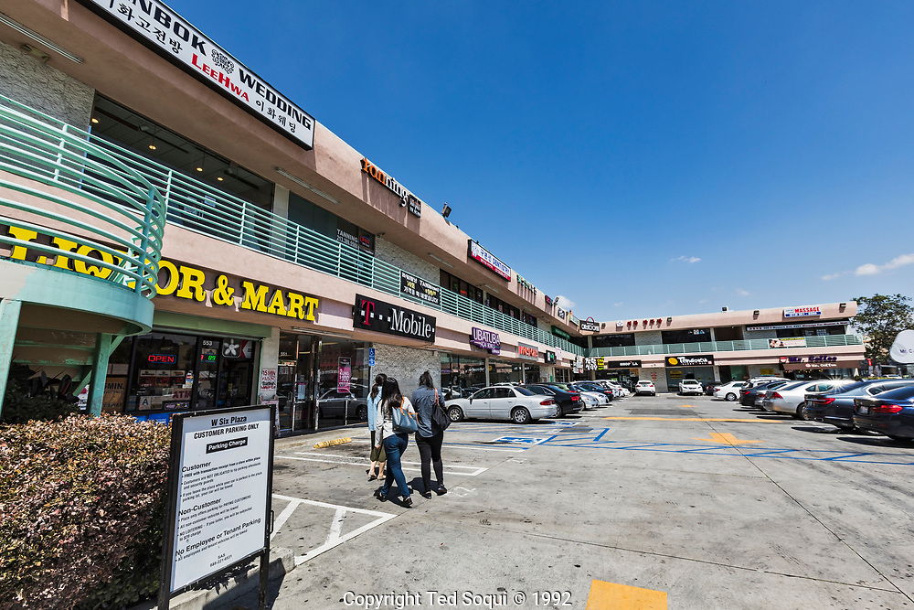 25 years later. The mini mall was completely rebuilt and the Koreatown are saw immediate redevelopment. The area is now a prime area of LA featuring hotel, fine dinning, and entertainment.<br /> <br /> 25 before and after LA92 photo project.