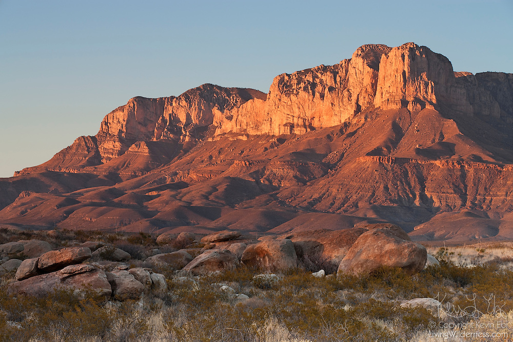 The Guadalupe Mountains in western Texas are turned golden by the setting sun. The iconic El Capitan (8085 feet/2464 meter) is visible at right. Guadalupe Peak, the highest point in Texas at 8749 feet (2667 meters) is at left.