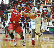 "Rutgers' Myles Mack (4) and Mississippi's Nick Williams (20) chase a ball at the C.M. ""Tad"" Smith Coliseum in Oxford, Miss. on Saturday, December 1, 2012. Mississippi won 80-67. (AP Photo/Oxford Eagle, Bruce Newman).."