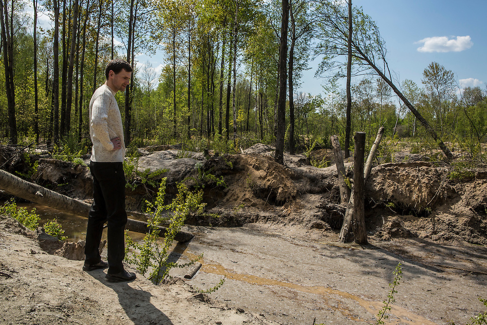 Oleksandr Zadorozhny, a member of the district council, shows a site of illegal amber mining on Wednesday, May 4, 2016 in Dubrovytsya, Ukraine.