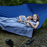 After a swim, sisters Janessa, left, and Brittney Parsons find a hammock a cozy place to warm up at their family's campsite at Deception Pass State Park.  Joshua Trujillo / Seattle Post-Intelligencer