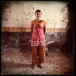 iPhone portrait of Rajyanti Bairwa, 17, in a village outside of Tonk, Rajasthan, India, April 3, 2013. &quot;I came to school and told the girls 'I am about to get married' and asked the girls go to my parents and tell them not to let the marriage happen. With their help, I refused the marriage because I want to study and be something. In life I want to be a doctor,&quot; said Bairwa.<br /> <br /> Under Indian law, children younger than 18 cannot marry. Yet in a number of India&rsquo;s states, at least half of all girls are married before they turn 18, according to statistics gathered in 2012 by the United Nations Population Fund (UNFPA). However, young girls in the Indian state of Rajasthan&mdash;and even a few boys&mdash;are getting some help in combatting child marriage. In villages throughout Tonk, Jaipur and Banswara districts, the Center for Unfolding Learning Potential, or CULP, uses its Pehchan Project to reach out to girls, generally between the ages of 9 and 14, who either left school early or never went at all. The education and confidence-building CULP offers have empowered young people to refuse forced marriages in favor of continuing their studies, and the nongovernmental organization has provided them with resources and advocates in their fight.